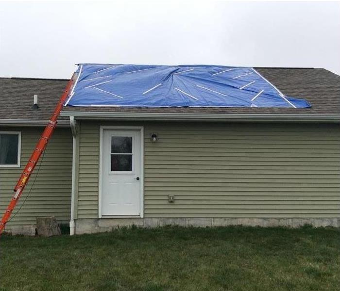 Storm Damage Devastates Roof After